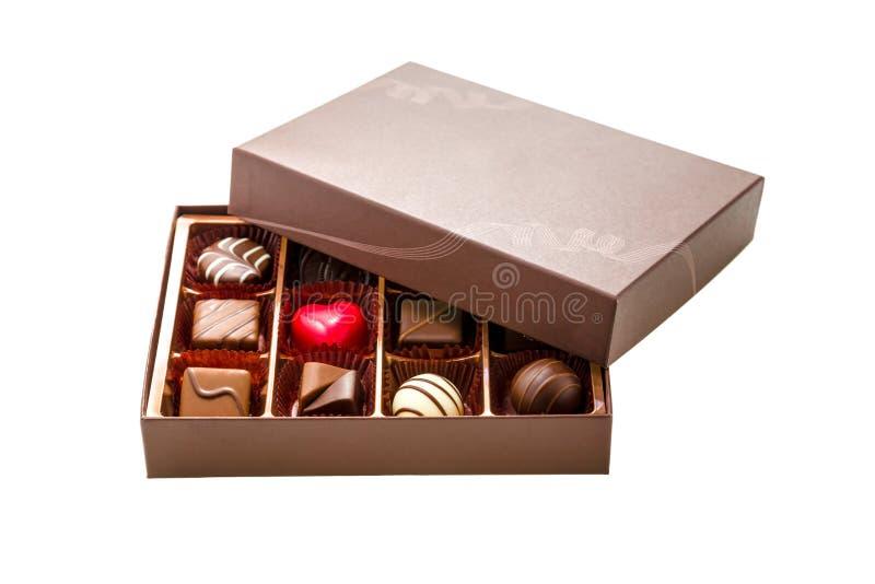 Bruine Doos Chocolade met Geassorteerde Chocolade stock afbeeldingen