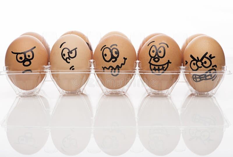 Bruine eieren over witte achtergrond royalty-vrije stock afbeeldingen