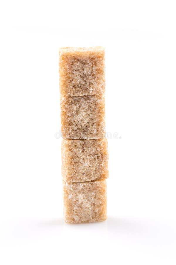 Bruine geïsoleerde suikerkubus stock foto
