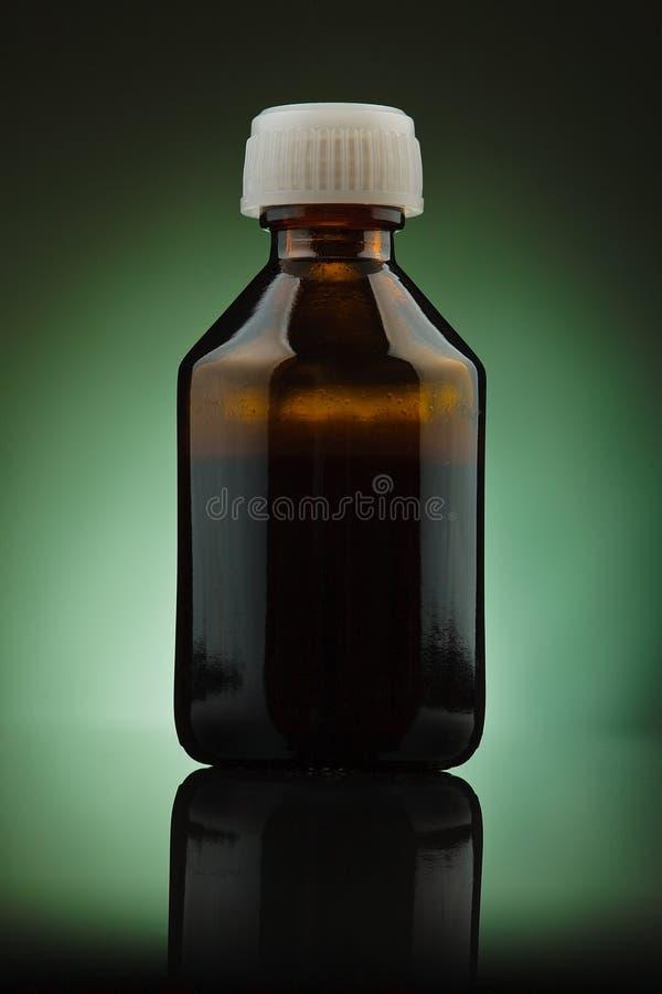Bruine geneeskundefles stock afbeelding