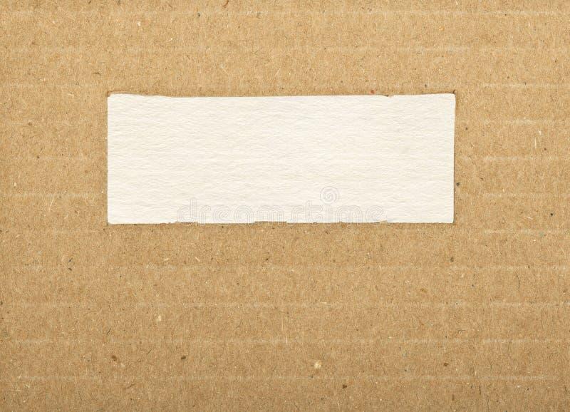 Bruine gestreepte kartondocument textuur met exemplaarruimte royalty-vrije stock afbeelding