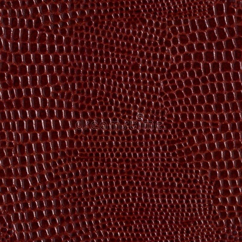 Bruine glanzende natuurlijke leerachtergrond De naadloze vierkante textuur, betegelt klaar royalty-vrije stock foto's