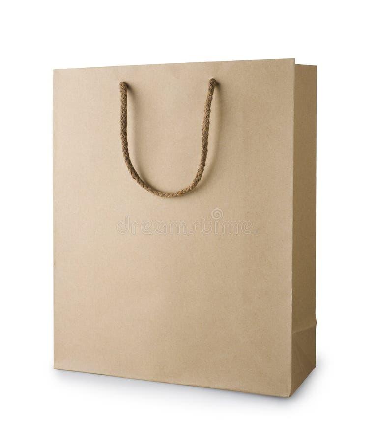Bruine kringloopdie het winkelen zak met handvatten op wit worden geïsoleerd stock fotografie