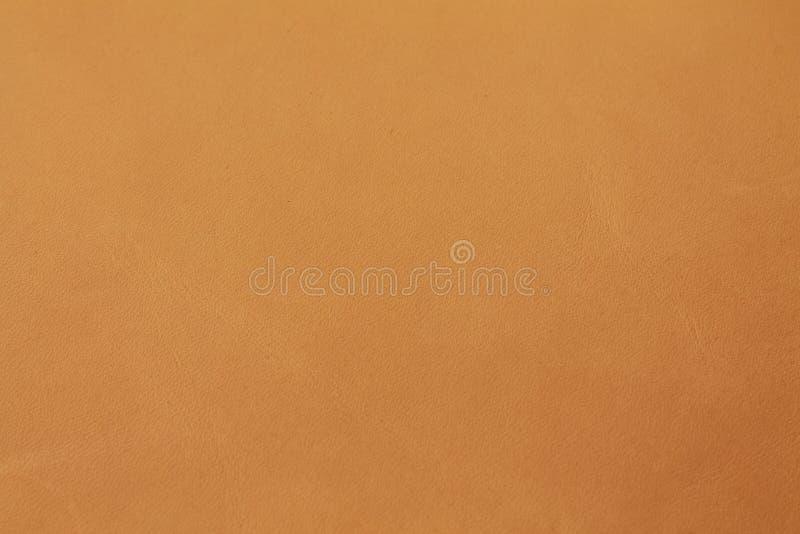 Bruine natuurlijke het leer van de kameelcognac plantaardige gelooide textuur als achtergrond royalty-vrije stock fotografie