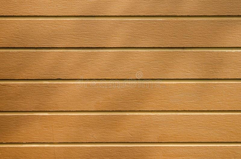 Bruine plankvloer met schaduw van bomen stock foto