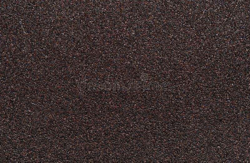 Bruine schuurpapierachtergrond stock foto's