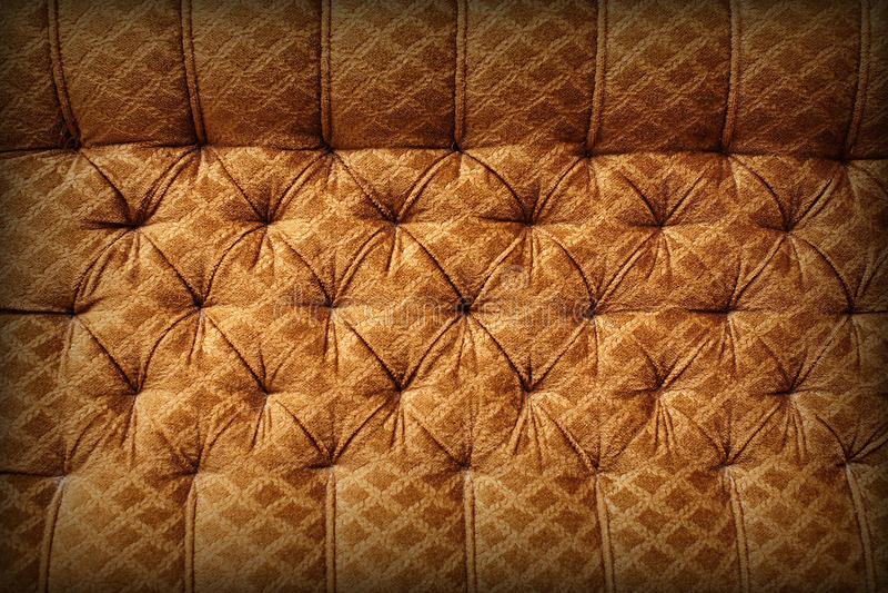 Bruine stoffering - retro achtergrond royalty-vrije stock afbeelding