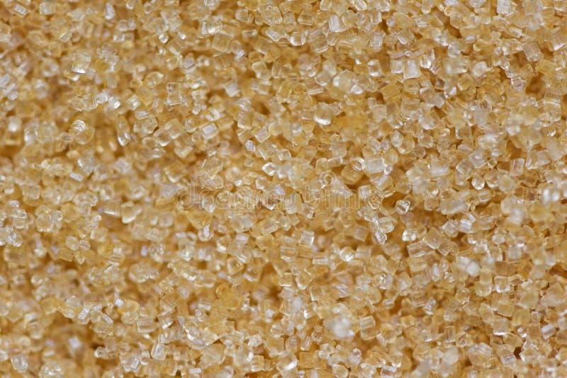 Bruine van de suikertextuur hoogste mening als achtergrond - sluit omhoog suiker stock foto's