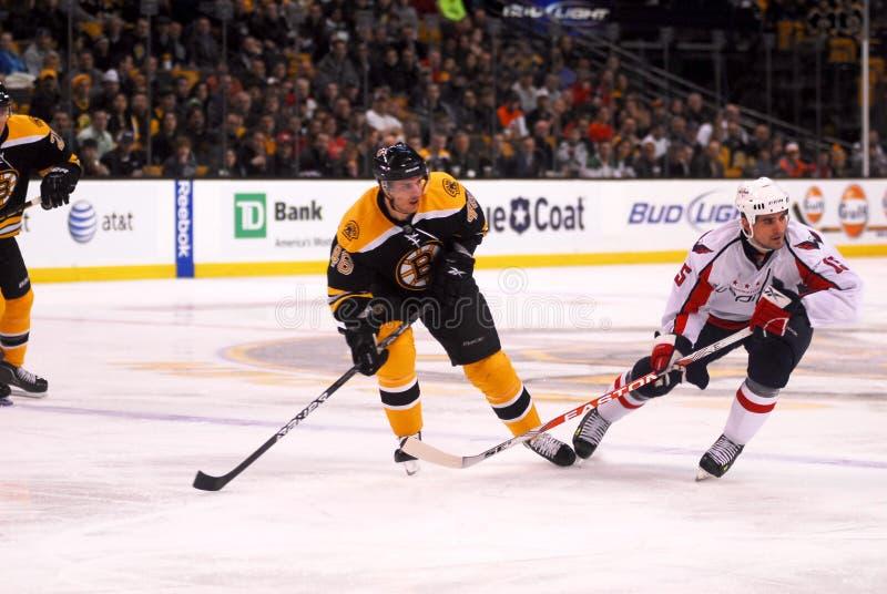 Bruins v. Capitals. Bruins Forward David Krejci (46) makes a pass despite the back checking of Capitals Forward Boyd Gordon (15 stock photos