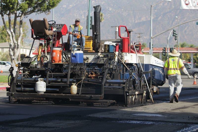 Brukarz asfaltowa maszyna zdjęcia royalty free