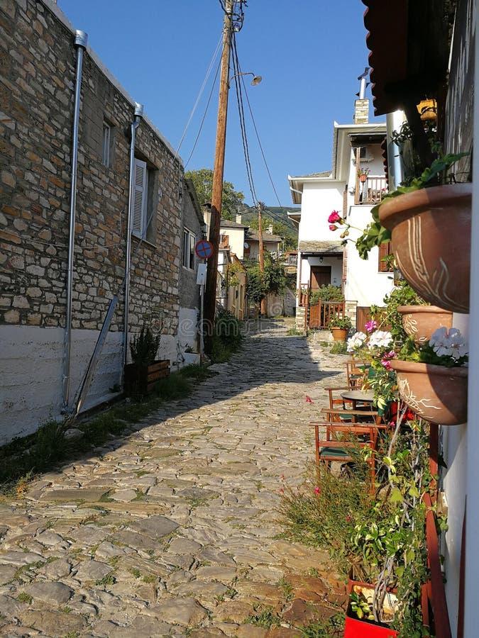 Brukowiec droga w Porta Ria, Grecja zdjęcie royalty free