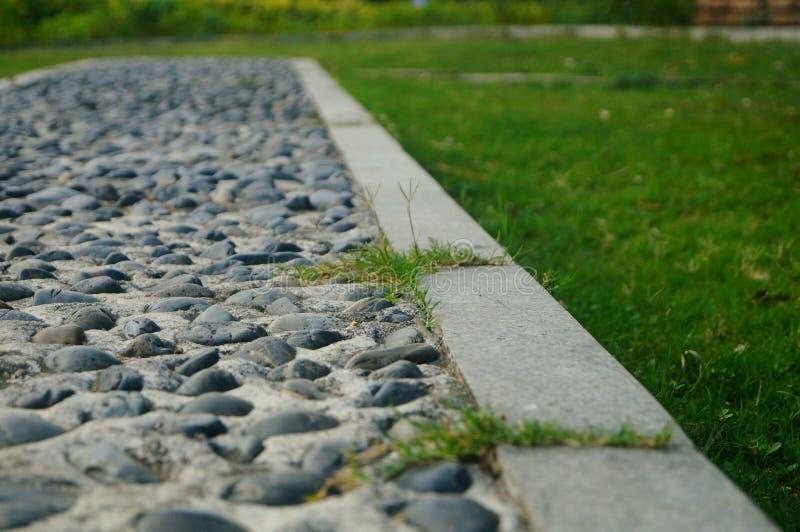 Brukowiec ziemia jako sprawność fizyczna w społeczność parku, zdjęcie stock