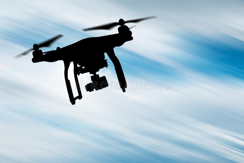 Brummen mit Fliegen der Kamera 4K lizenzfreies stockbild