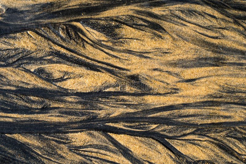 Brun bakgrund för abstrakt begrepp för sandstrandtextur arkivfoton