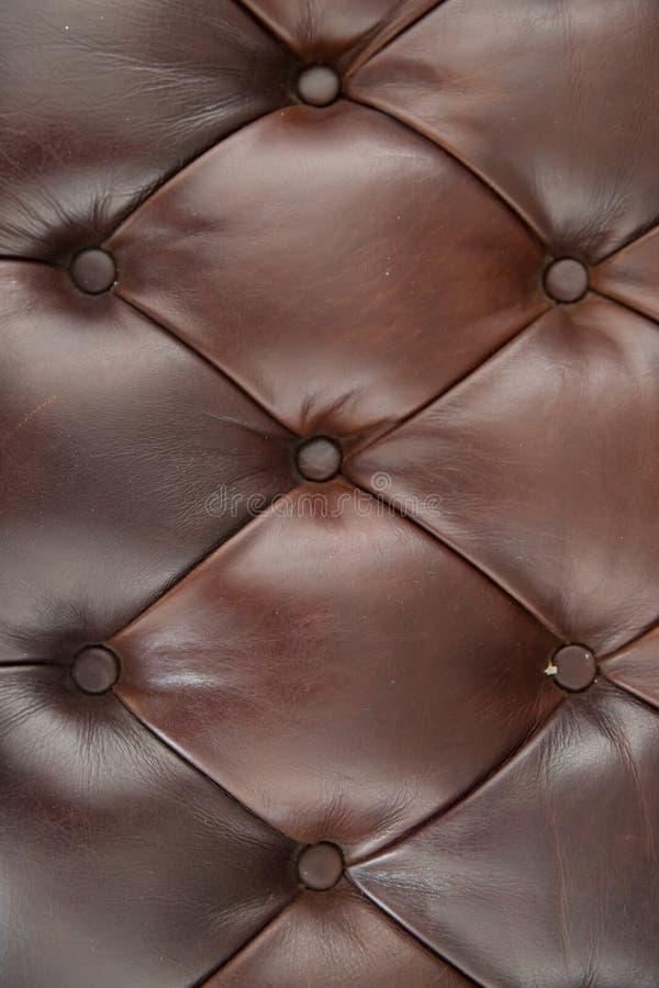 Brun bakgrund för lädersoffatextur royaltyfria bilder
