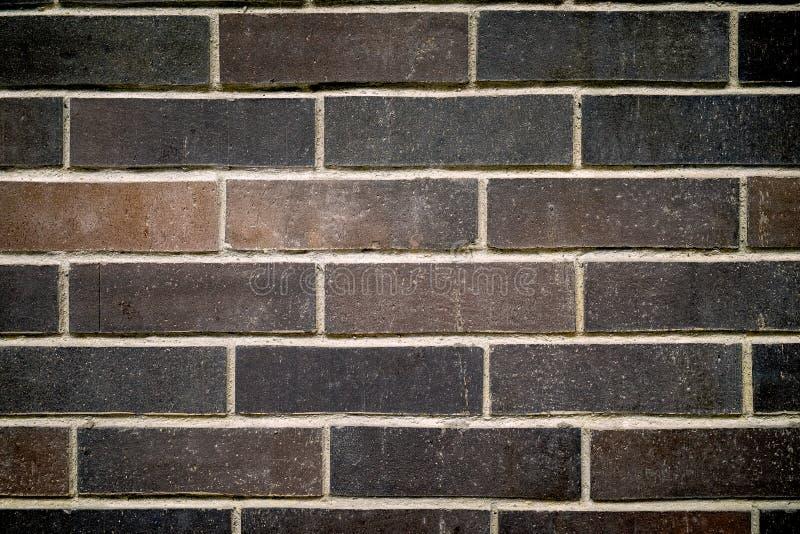 Brun bakgrund för tegelstenvägg arkivfoton