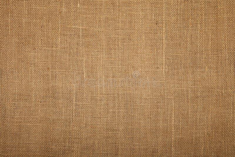 Brun bakgrund för textur för säckvävjutekanfas royaltyfria foton