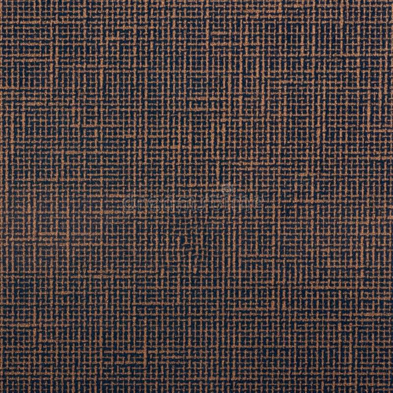 Brun bakgrund för woolen tyg royaltyfria foton