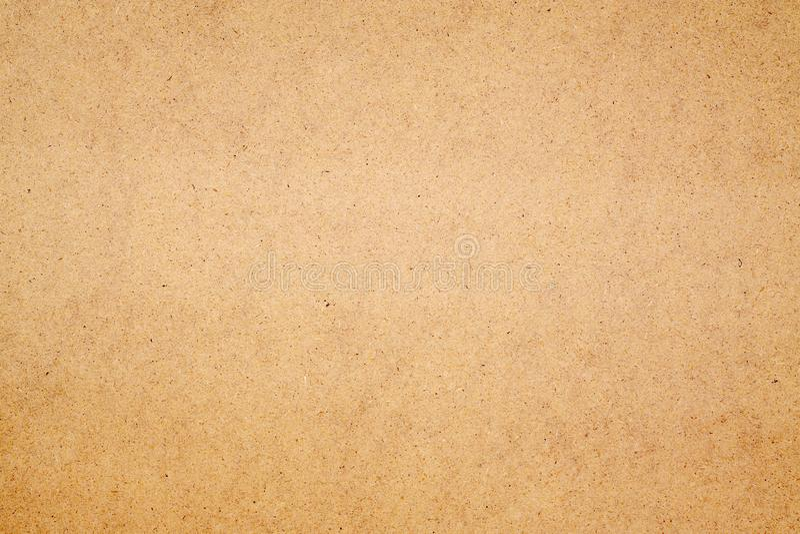Brun brädeträtextur som göras av återanvänt pappers- trä för bakgrundsanvändning arkivbilder