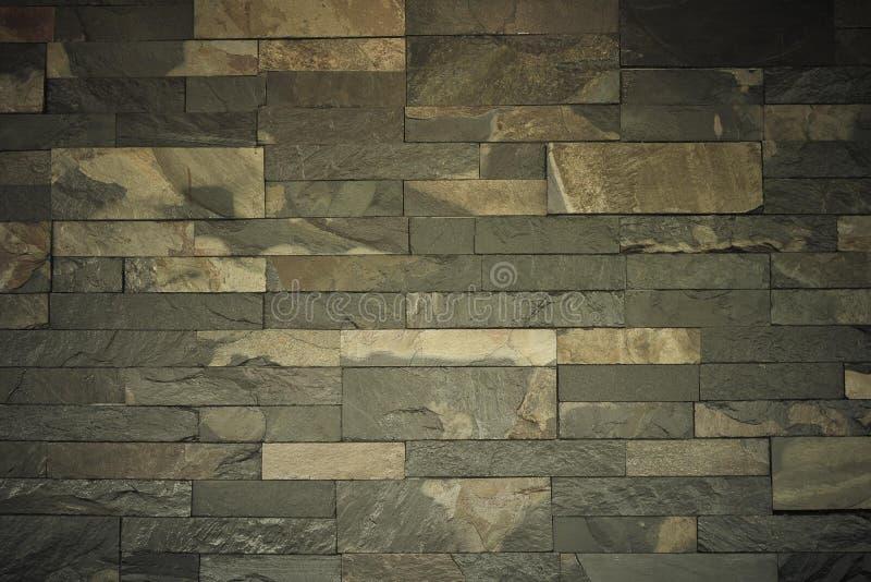 Brun granitmur som ser modern och vacker ut fotografering för bildbyråer