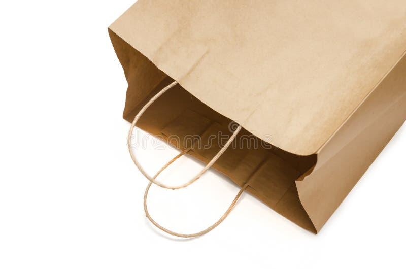 Brun pappers- påse från kraft papper öppna packen Iso för shoppingpåse arkivbilder