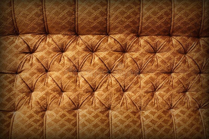 brun retro upholstery för bakgrund royaltyfri bild