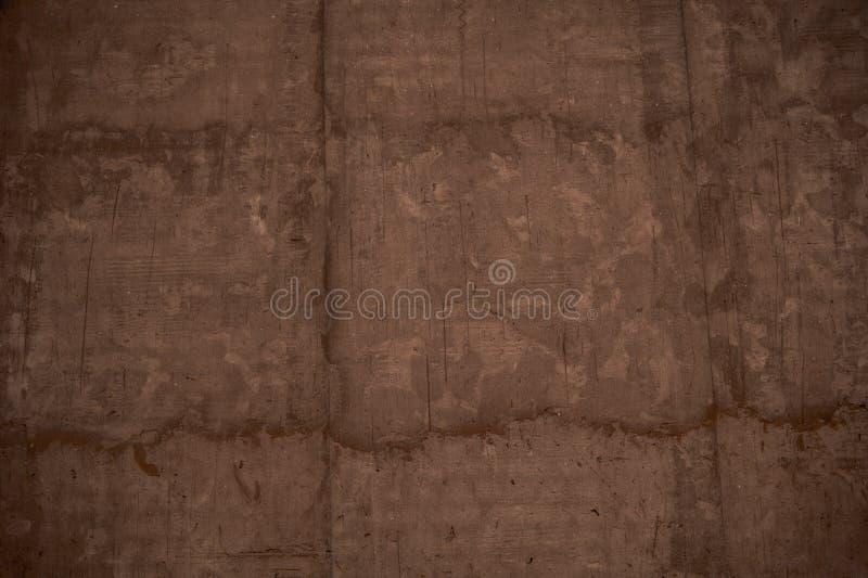 Brun stuckaturväggbakgrund, målad cementväggtextur fotografering för bildbyråer