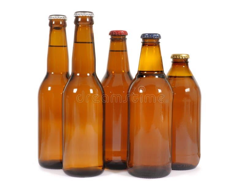 Bruna ölflaskor royaltyfria bilder
