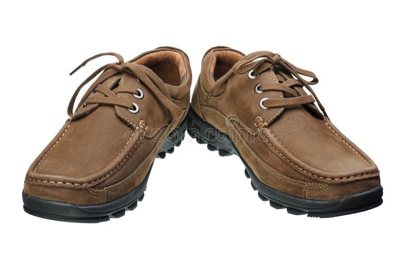 Bruna mäns skor arkivfoto