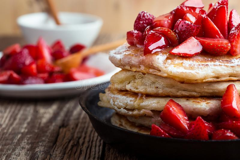 Strawberry  pancakes,  summer brunch rural table. Brunch, favorite morning meal. Homemade berry  pancakes, fresh summer dessert with strawberries, honey and royalty free stock photo