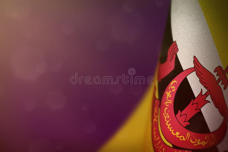 Brunei Darussalam flag for honour of veterans day or memorial day. Glory to the Brunei Darussalam heroes of war concept on purple. Brunei Darussalam hanging flag royalty free stock image