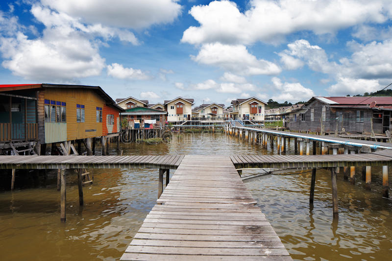 Brunei's famed water village. S are fully self sufficient, with their own mosques, schools, shops, piped water, electricity and satellite TV. For transportation royalty free stock photo