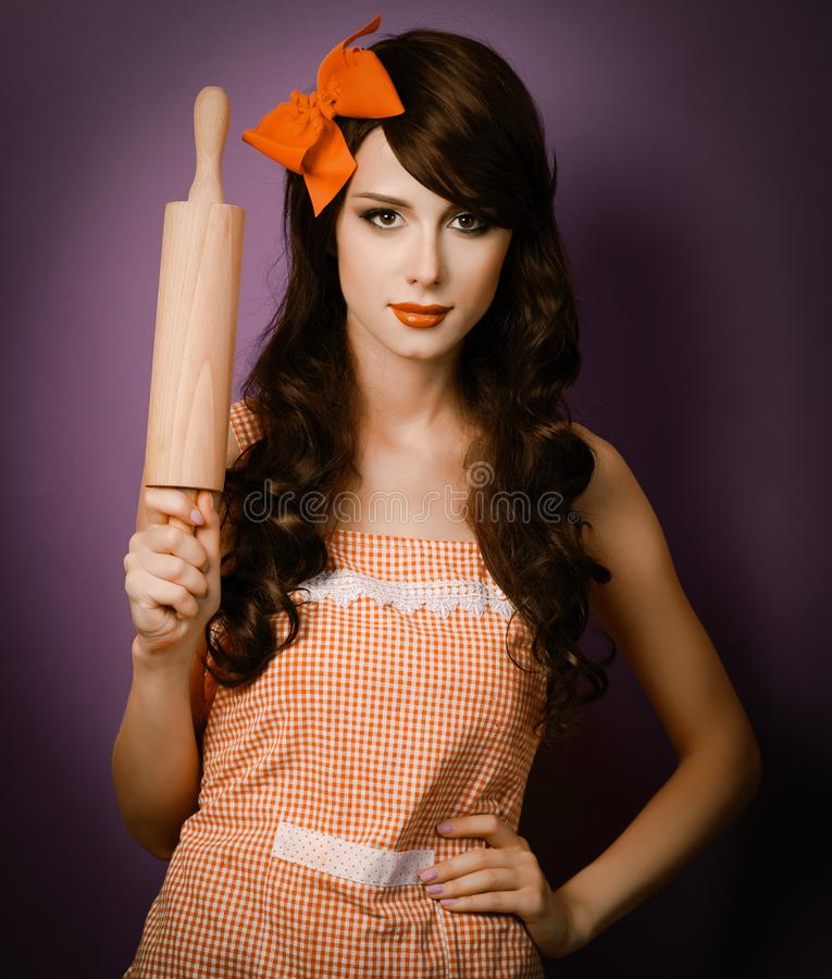 Brunet housewife with rolling pin stock photos