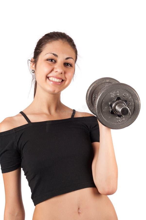 brunetka robi sprawność fizyczna ciężarom obrazy stock