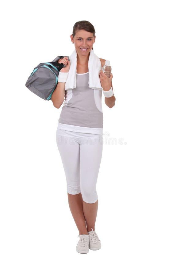 Brunetka ubierająca w sportswear zdjęcie royalty free
