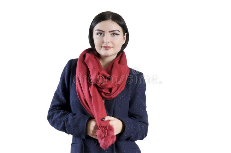 Brunetki dziewczyna w żakiecie i szaliku odizolowywających zdjęcia stock