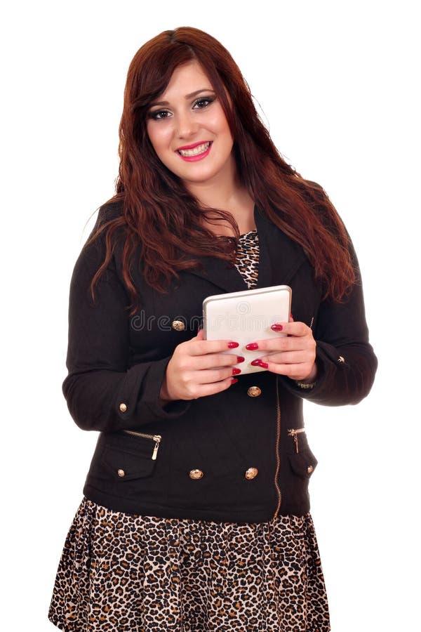 Brunetki dziewczyna z pastylka komputerem osobistym zdjęcie royalty free
