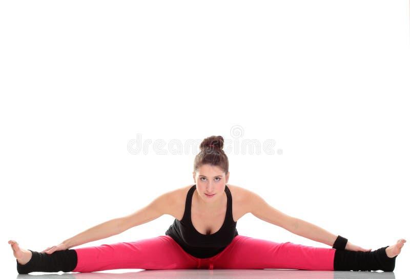 brunetki kobiety rozciągania mięśni ręki odizolowywali zdjęcie stock