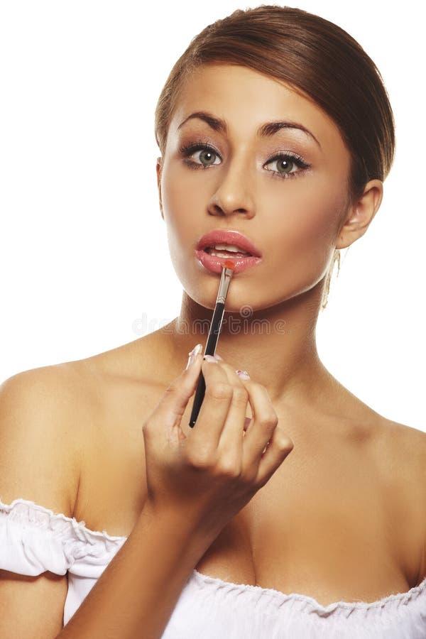 brunett som gör morgonrutinkvinnan royaltyfria foton