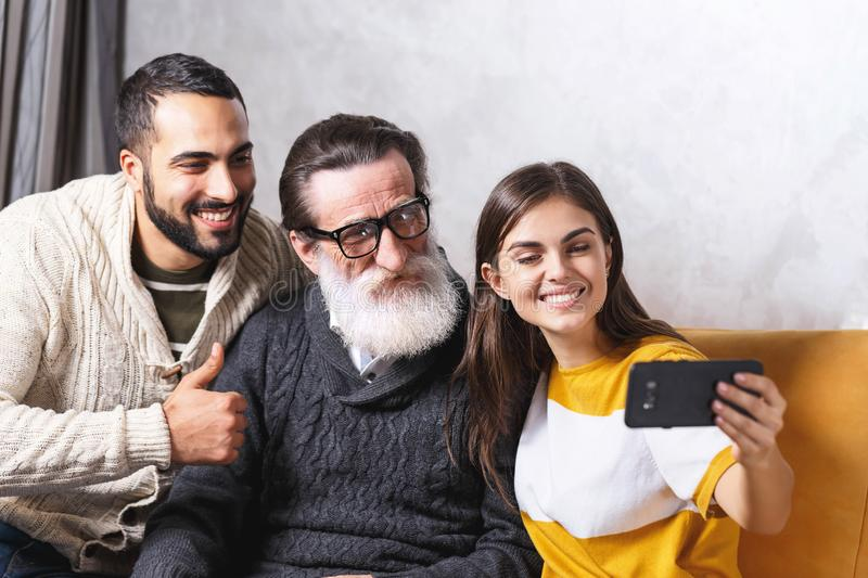 Senior Man Sitting With His Children stock images