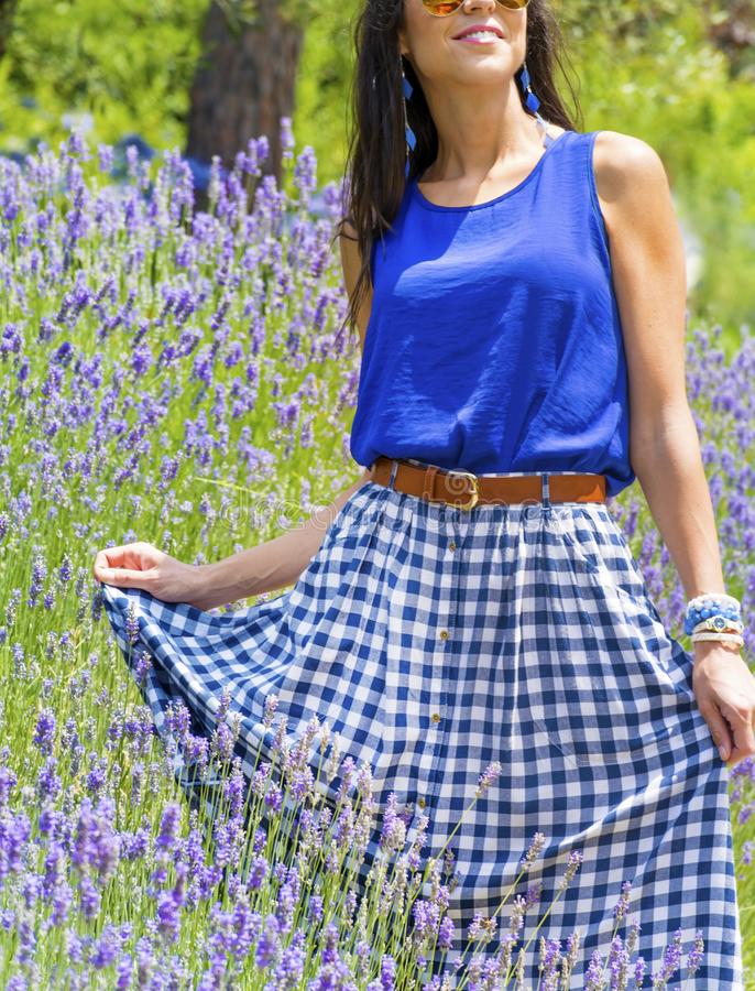 Young Beautiful Fashion Woman. Brunette beautiful woman with blue vest and checkered skirt stock images