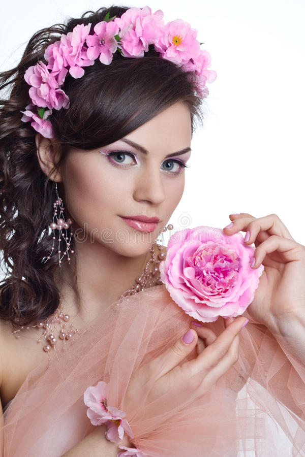 Brunette beautiful woman with flowers royalty free stock image