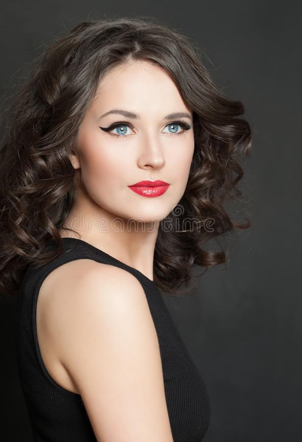 Brunette beauty portrait. Beautiful model woman with red lips makeup.  royalty free stock images