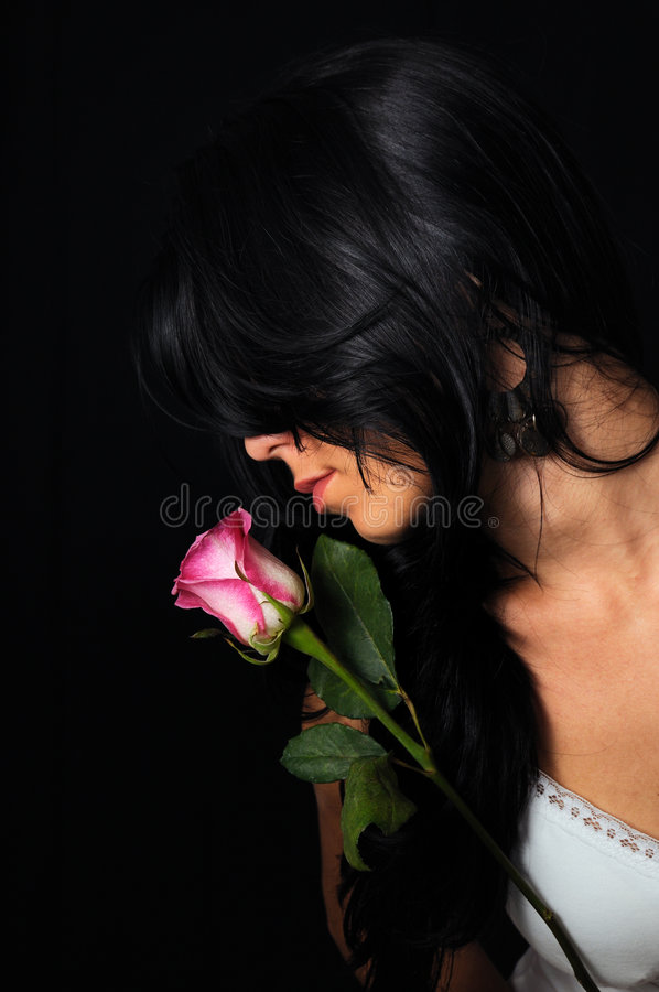 Brunette beauty with rose stock image
