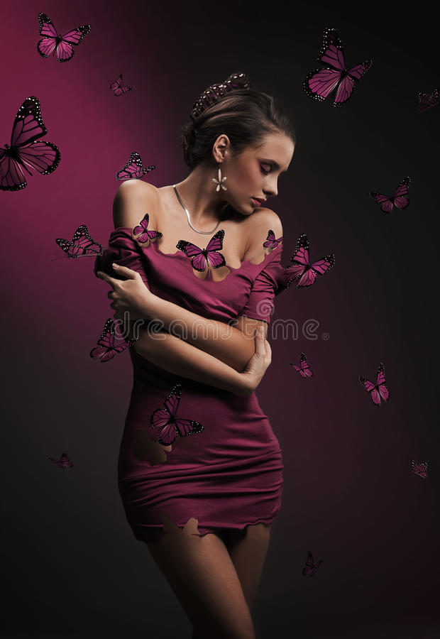 Brunette beauty and violet butterflies royalty free stock images