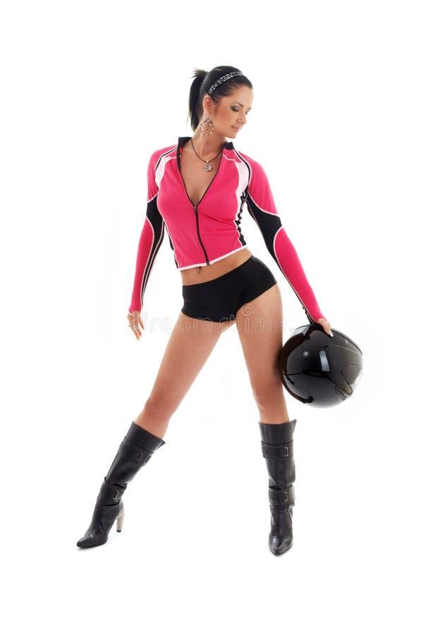 Brunette biker girl with black stock images