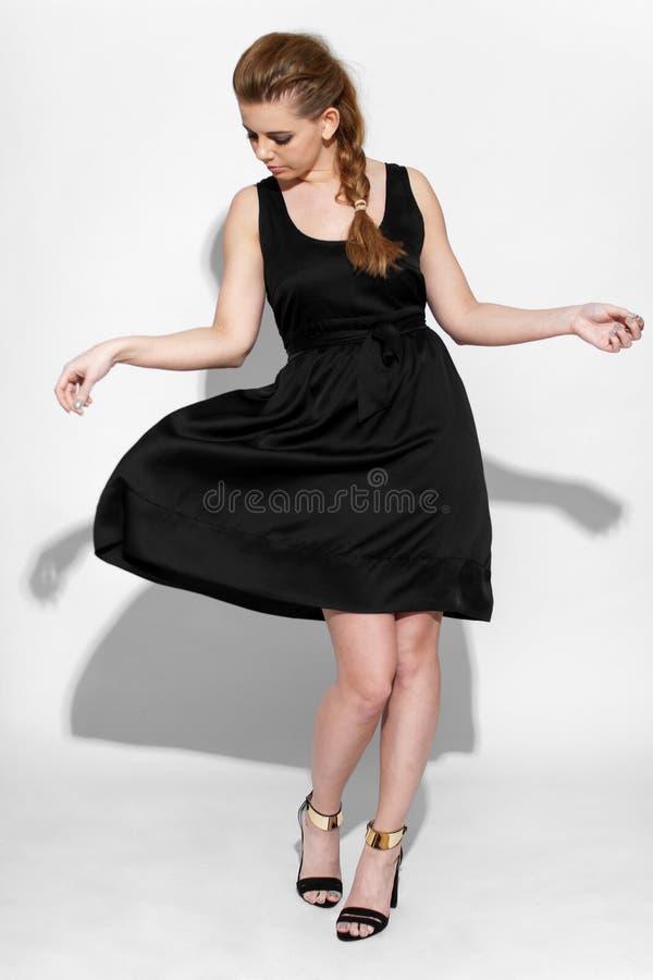 Brunette in black dress stock images