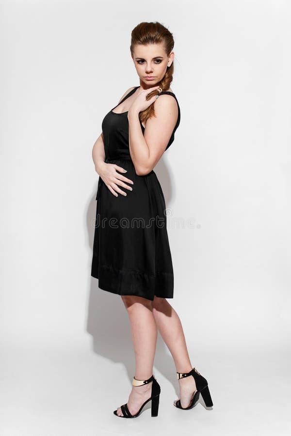 Brunette in black dress stock photo