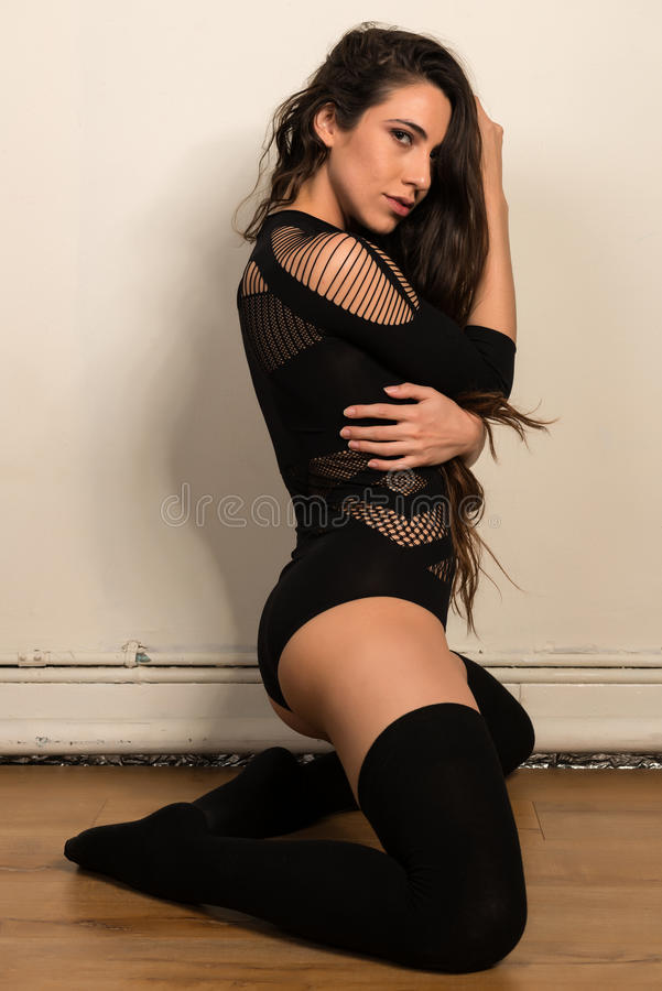 Brunette in black royalty free stock image
