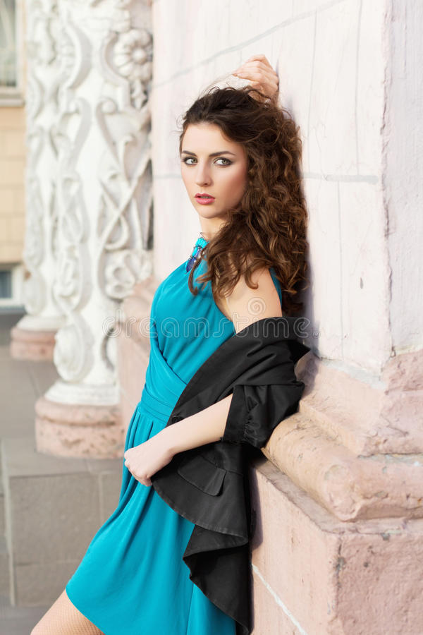 Brunette in blue dress stock photos